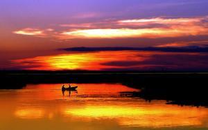 rowboat sunset